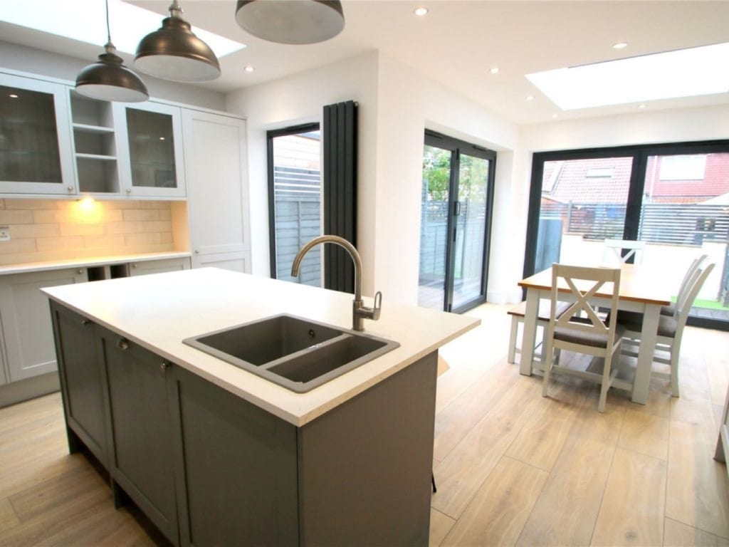 Kitchen extension with island and bifold doors
