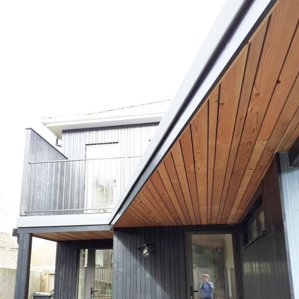 Timber-clad extension to dwelling