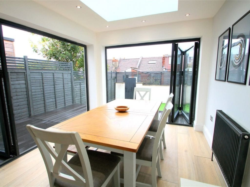 Dining space with bifold doors on two sides